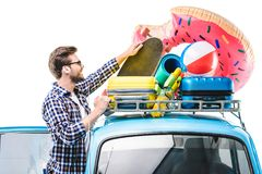 Man with lugagge on car ruff Royalty Free Stock Photos