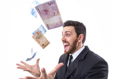 Happy young man in a rain of Brazilian Money Stock Photography