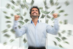 Happy young man in a rain of money Royalty Free Stock Images