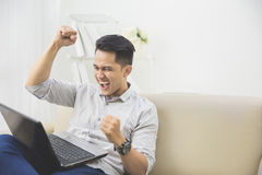 Happy young man raise his hand. success Stock Photo