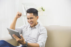 Happy young man raise his hand. success Stock Photography