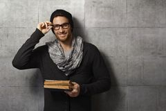 Happy young man reading book Stock Images