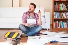 Man portrait and do it yourself furniture assembly royalty free stock photography