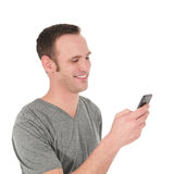 Happy young man reading a text message Stock Photography