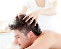 Happy young man receiving a head massage Stock Photos