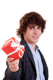 Happy young man, with a red gift Stock Photo