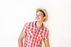 Happy young man in red shirt smiling with hat Stock Image