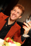 Happy man in suit with a glass of wine Royalty Free Stock Photo