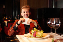 Happy man in suit holding a napkin Royalty Free Stock Images