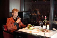 Happyman in red suit in a restaurant Royalty Free Stock Image