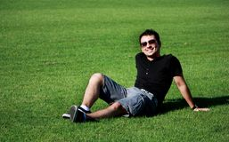 Happy young man relaxing  Royalty Free Stock Photo