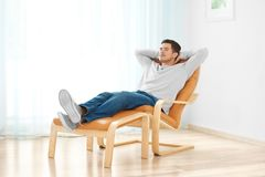 Happy young man relaxing. At home stock photos