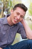 Happy young man relaxing outdoors Stock Photo