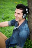 Happy young man relaxing outdoors Stock Photos