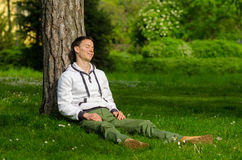 Happy young man relaxing in the park Royalty Free Stock Photos