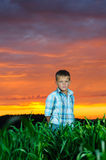 Happy young man rest on green field Stock Photos