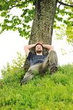 Happy young man resting Stock Images