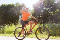 Happy young man riding bicycle outdoors Stock Image