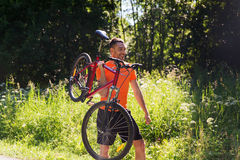 Happy young man riding bicycle outdoors Royalty Free Stock Images