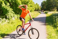 Happy young man riding bicycle outdoors Royalty Free Stock Photos