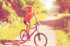 Happy young man riding bicycle outdoors Stock Photo