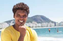 Happy young man from Rio in a yellow shirt at Copacabana Royalty Free Stock Photography