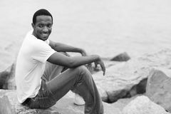 Happy young man on the rocks Royalty Free Stock Photography