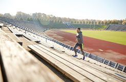 Happy young man running upstairs on stadium Royalty Free Stock Image