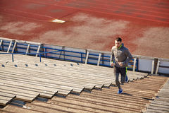 Happy young man running upstairs on stadium Stock Images