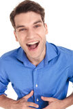 Happy young man screaming at the camera. Royalty Free Stock Photo