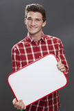 Happy young man searching for a job with blank panel Stock Photography