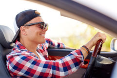 Happy young man in shades driving convertible car Stock Photos