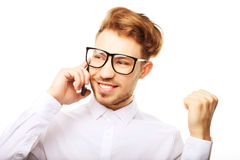 Happy young man in shirt  gesturing and smiling while talking on Stock Photo