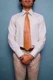 Happy young man in shirt and tie stock photo