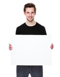 Happy young man showing and displaying placard Stock Photos