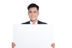 Happy young man showing and displaying placard ready for your te Royalty Free Stock Images