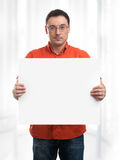 Happy young man showing and displaying placard Royalty Free Stock Images