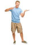 Happy young man showing empty copyspace on white background Royalty Free Stock Photos