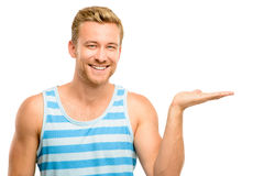 Happy young man showing empty copyspace on white background Stock Image