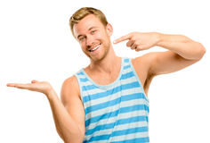 Happy young man showing empty copyspace on white background Stock Photography