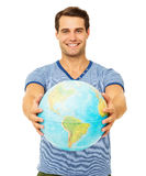Happy Young Man Showing Globe Royalty Free Stock Photography