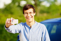 Happy young man showing his driving license Royalty Free Stock Images