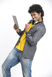 Happy Young Man showing his success with Digital Tablet stock image