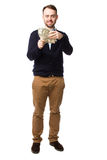 Happy young man showing off a handful of money Stock Photography
