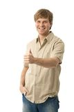 Happy young man showing OK signing. Happy young man showing OK sign with thumb up, smiling. Isolated on white Stock Photos