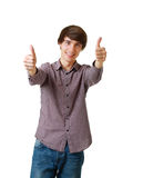Happy young man showing a success Stock Image