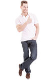 Happy young man showing thumb up. Full length portrait of a happy young man showing thumb up, isolated on white background Stock Photography