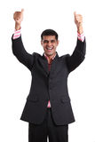Happy young man showing thumbs up. Happy young man in a business suit showing thumbs up and smiling on white background royalty free stock photos