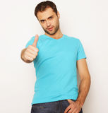 Happy young man showing thumbs up Royalty Free Stock Images