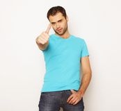 Happy young man showing thumbs up Royalty Free Stock Photos